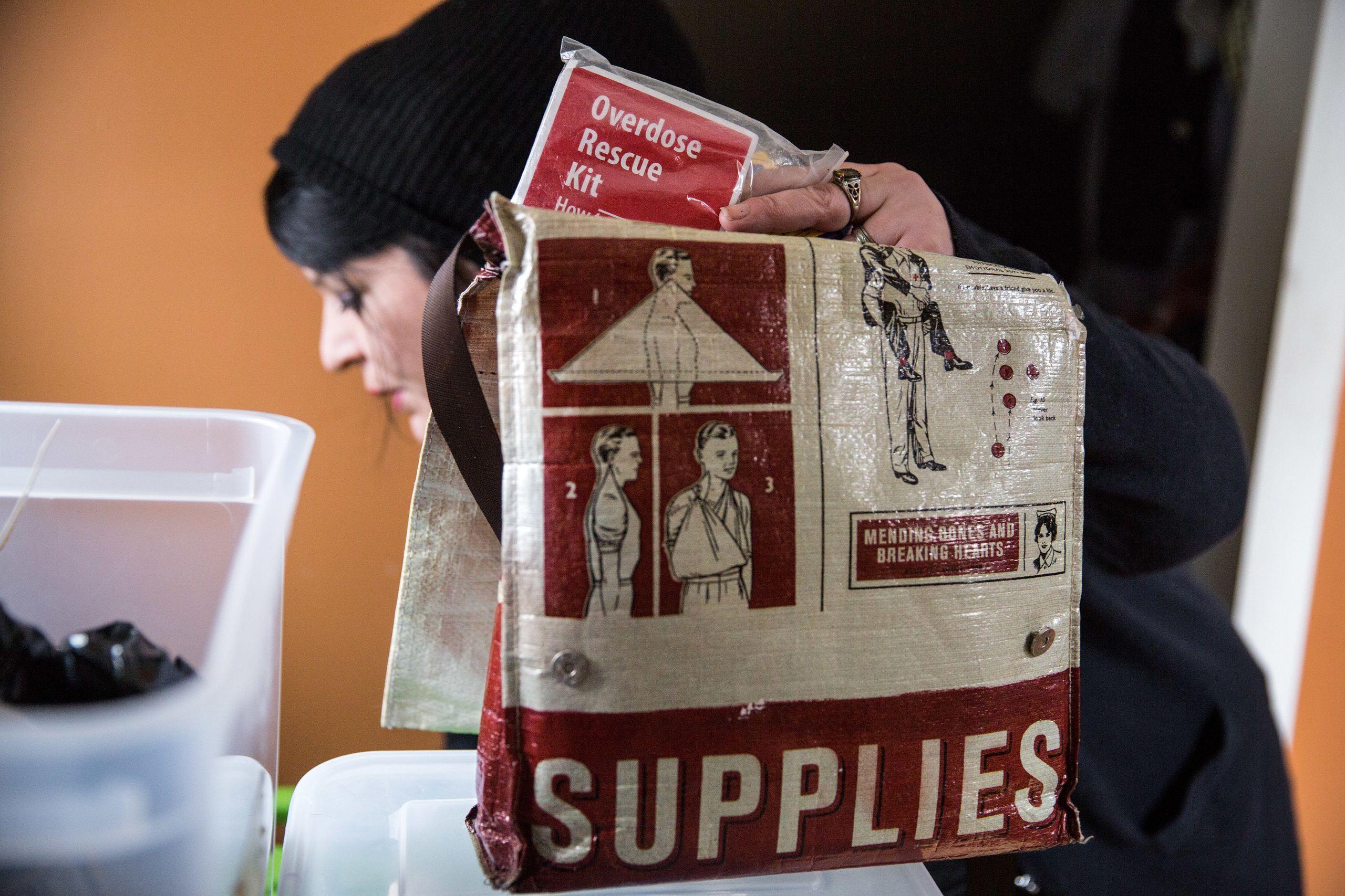 Tilley puts together a bag of safer injection supplies.