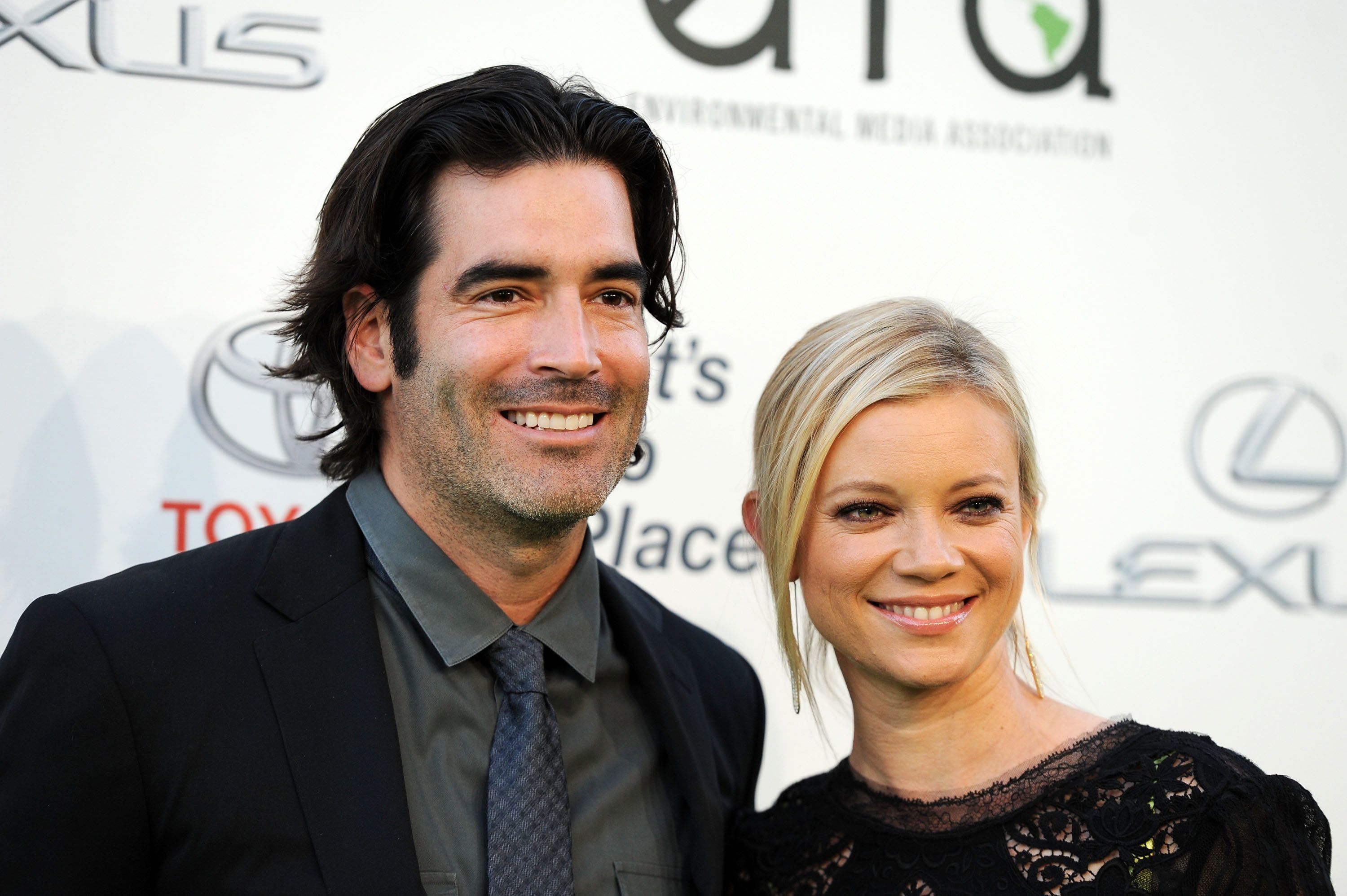 BURBANK, CA - OCTOBER 19:  Television personality Carter Oosterhouse (L) and actress Amy Smart arrive at the 2013 Environmental Media Awards at Warner Bros. Studios on October 19, 2013 in Burbank, California.  (Photo by Amanda Edwards/WireImage)