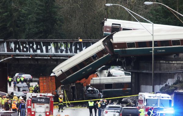 At least six people were killed when a passenger train car plunged from the bridge.