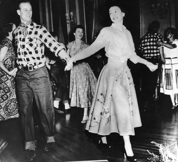 Philip and Elizabeth show off theirsquare dance moves in 1951 in Ottawa, Canada, on one of many royal visits they made