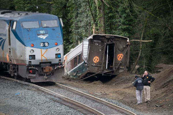 Law enforcement work at the scene of a Amtrak train derailment in DuPont, Washington.