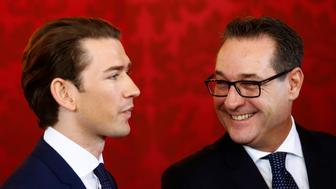 Austrian Vice Chancellor Heinz-Christian Strache (R) of the Freedom Party (FPOe) smiles next to Chancellor Sebastian Kurz of the People's Party (OeVP) during their swearing-in ceremony at the presidential office in Vienna, Austria, December 18, 2017. REUTERS/Leonhard Foeger