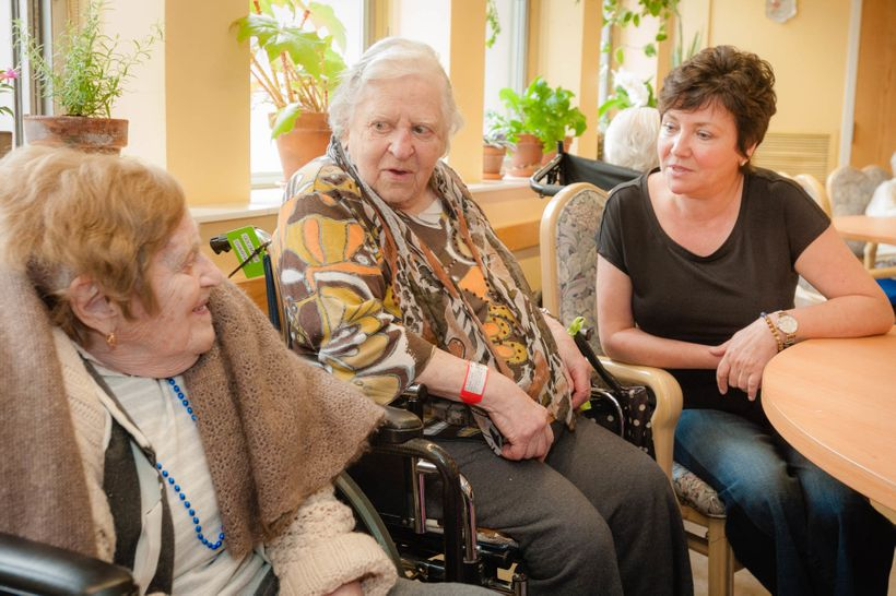 A chaplain visits with residents at Hebrew Senior Life, Roslindale, MA