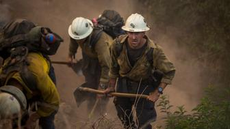 Crew battles the Montecito blaze in California