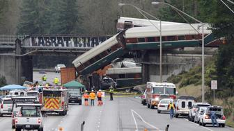 Rescue personnel and equipment are seen at the scene where an Amtrak passenger train derailed on a bridge over interstate highway I-5  in DuPont, Washington, U.S. December 18, 2017. REUTERS/Steve Dipaola