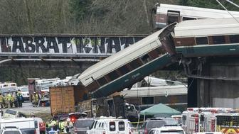 The scene of a portion of the Interstate I-5 highway after an Amtrak high speed train derailled from an overpass early December 18, 2017 near the city of Tacoma, Washington state.   'Multiple' people were killed when the Amtrak passenger train derailed, sending cars flying off a bridge and onto a busy interstate, officials said. The train, which was carrying 78 passengers and five crew, was part of a newly expanded faster rail service along the route linking Seattle and Portland, Oregon -- featuring new locomotives. / AFP PHOTO / Kathryn ELSESSER        (Photo credit should read KATHRYN ELSESSER/AFP/Getty Images)