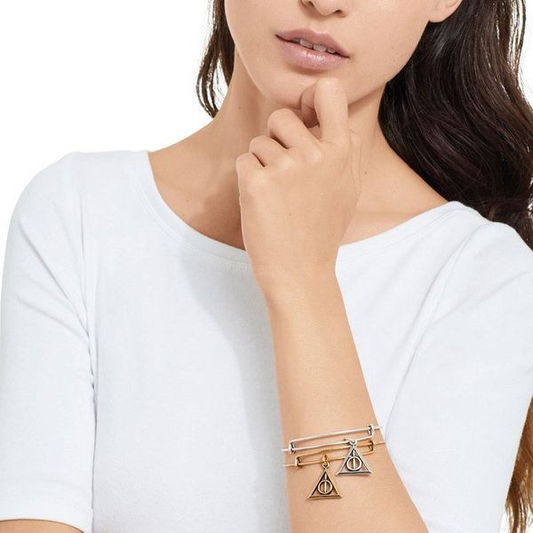 "Get it <a href=""https://www.alexandani.com/collections/collaborations/deathly-hallows-charm-bangle-super-as17hp21rg.html"" tar"