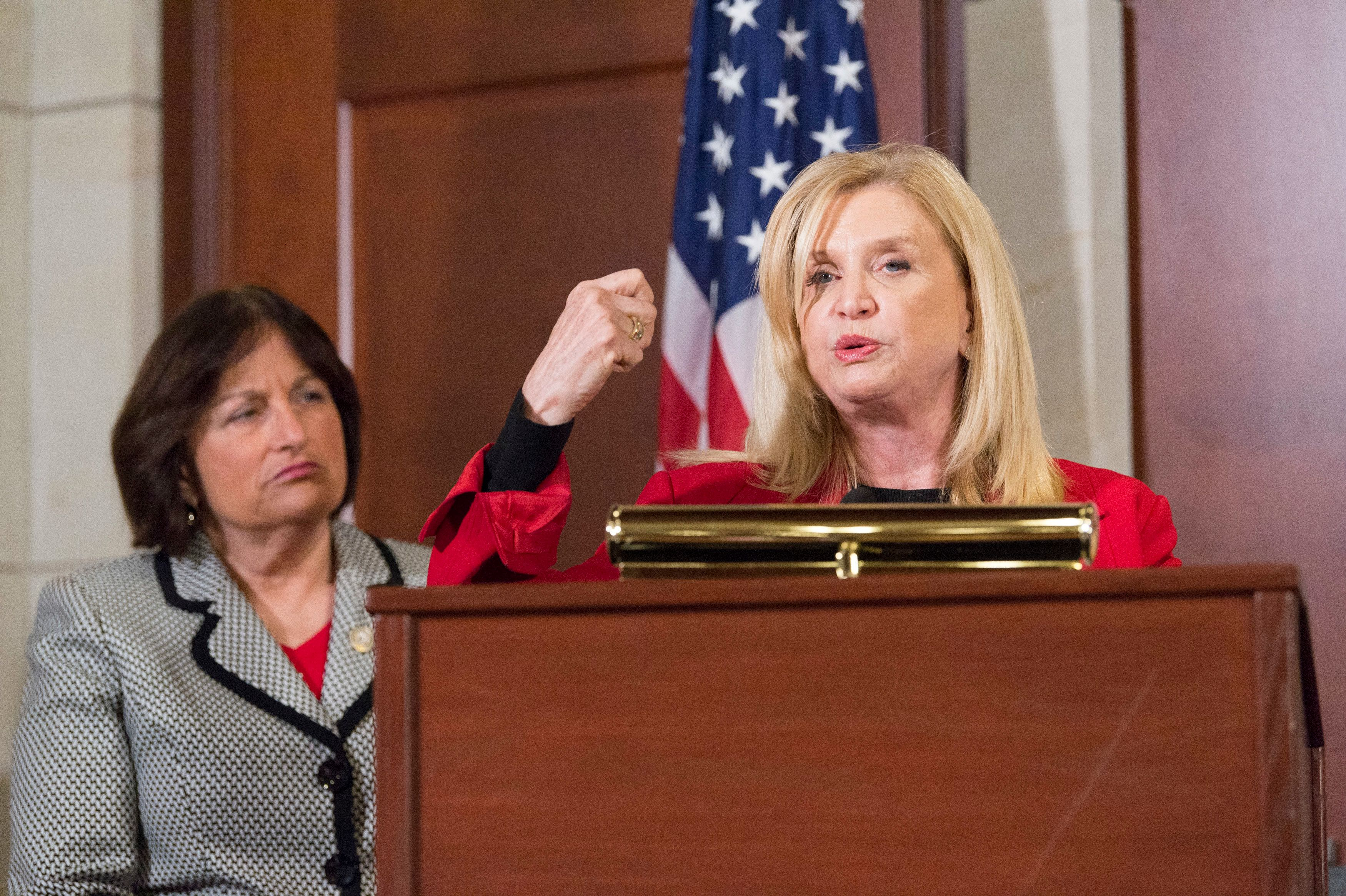 Rep. Carolyn Maloney, flanked by Rep. Annie Kuster, speaks out against workplace cover-ups of sexual misconduct.