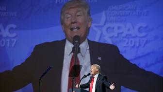 With his image projected upon a huge screen, U.S. President Donald Trump speaks at the Conservative Political Action Conference, or CPAC, in Oxon Hill, Maryland, U.S., February 24, 2017.  REUTERS/Kevin Lamarque