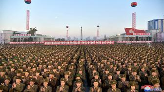 TOPSHOT - This December 1, 2017 picture released by North Korea's official Korean Central News Agency (KCNA) on December 2, 2017 shows North Korean soldiers and Pyongyang residents holding a rally to celebrate the North's declaration on November 29 it had achieved full nuclear statehood. North Korea's leader Kim Jong-Un declared the country had achieved a 'historic cause' of becoming a nuclear state, its state media said on November 29, after the country tested an intercontinental ballistic missile earlier in the day.  / AFP PHOTO / KCNA VIA KNS / - / South Korea OUT / REPUBLIC OF KOREA OUT   ---EDITORS NOTE--- RESTRICTED TO EDITORIAL USE - MANDATORY CREDIT 'AFP PHOTO/KCNA VIA KNS' - NO MARKETING NO ADVERTISING CAMPAIGNS - DISTRIBUTED AS A SERVICE TO CLIENTS THIS PICTURE WAS MADE AVAILABLE BY A THIRD PARTY. AFP CAN NOT INDEPENDENTLY VERIFY THE AUTHENTICITY, LOCATION, DATE AND CONTENT OF THIS IMAGE. THIS PHOTO IS DISTRIBUTED EXACTLY AS RECEIVED BY AFP.  /         (Photo credit should read -/AFP/Getty Images)