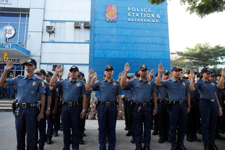 Policemen swear allegiance to the Constitution.