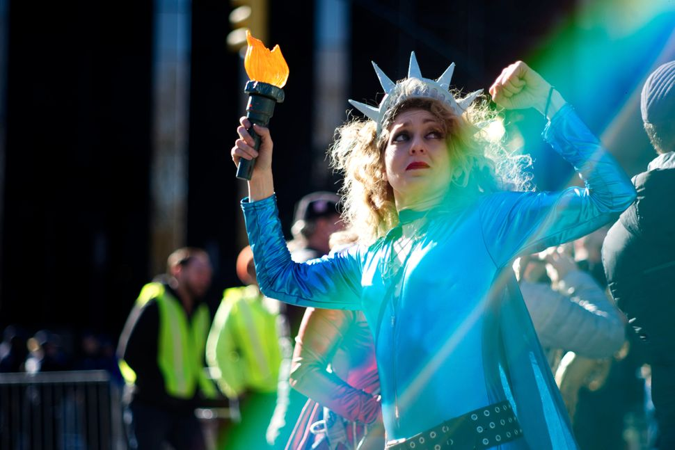 Lady Liberty dances during the Not My Presidents Day rally near Trump International Hotel and Tower in New York City on