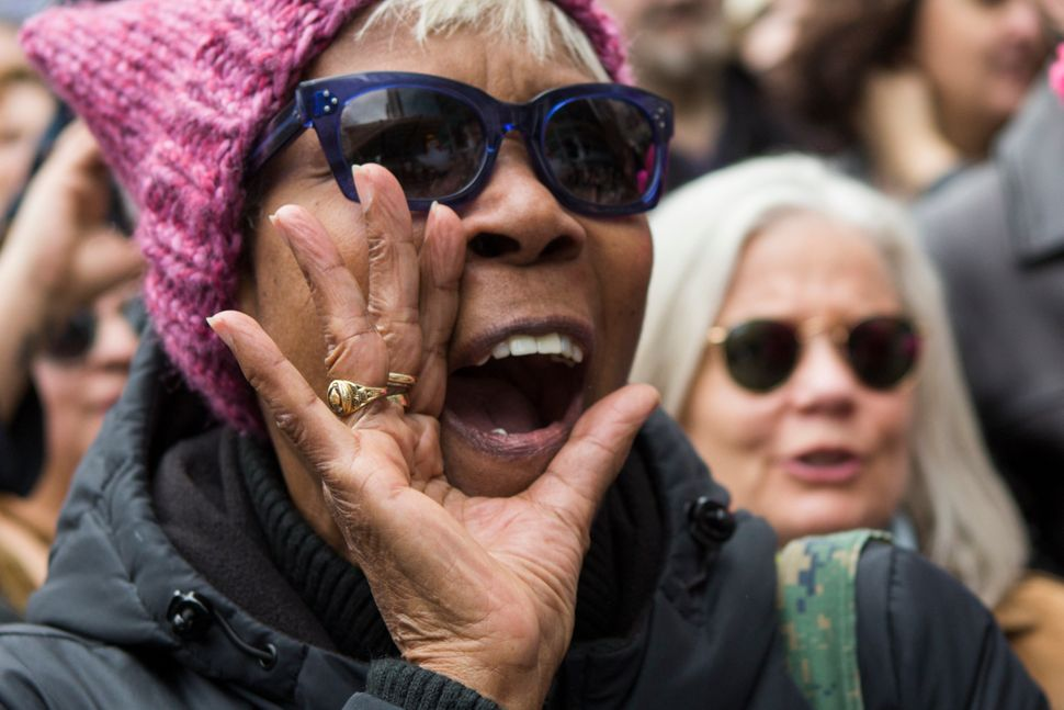 A woman shouts slogans against Trump as activists take part in a Tax Day protest on April 15, 2017, in New York City.