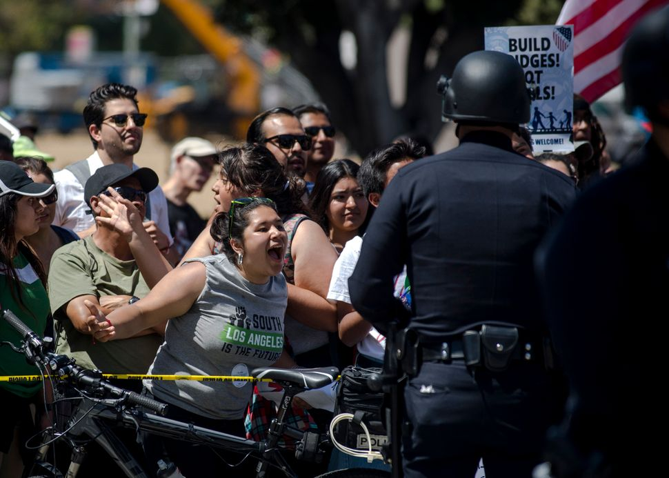 Protesters participate in a May Day march in Los Angeles, May 1, 2017. Thousands of Americans took to the streets in major U.