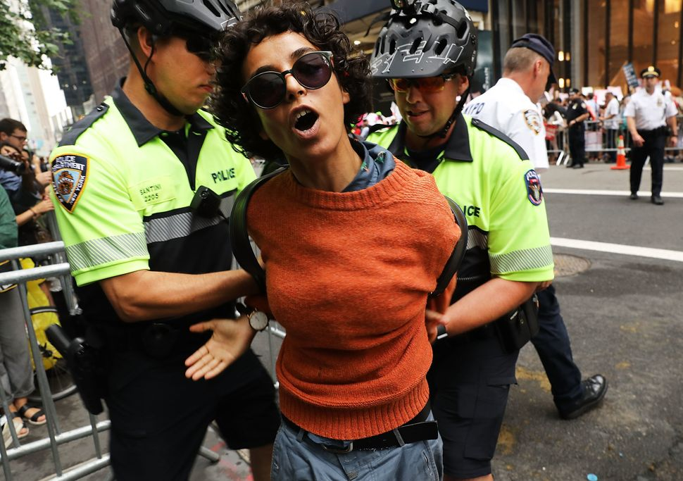 A woman is arrested during a pro-immigration rally outside Trump Tower on Aug. 15, 2017, in New York City.
