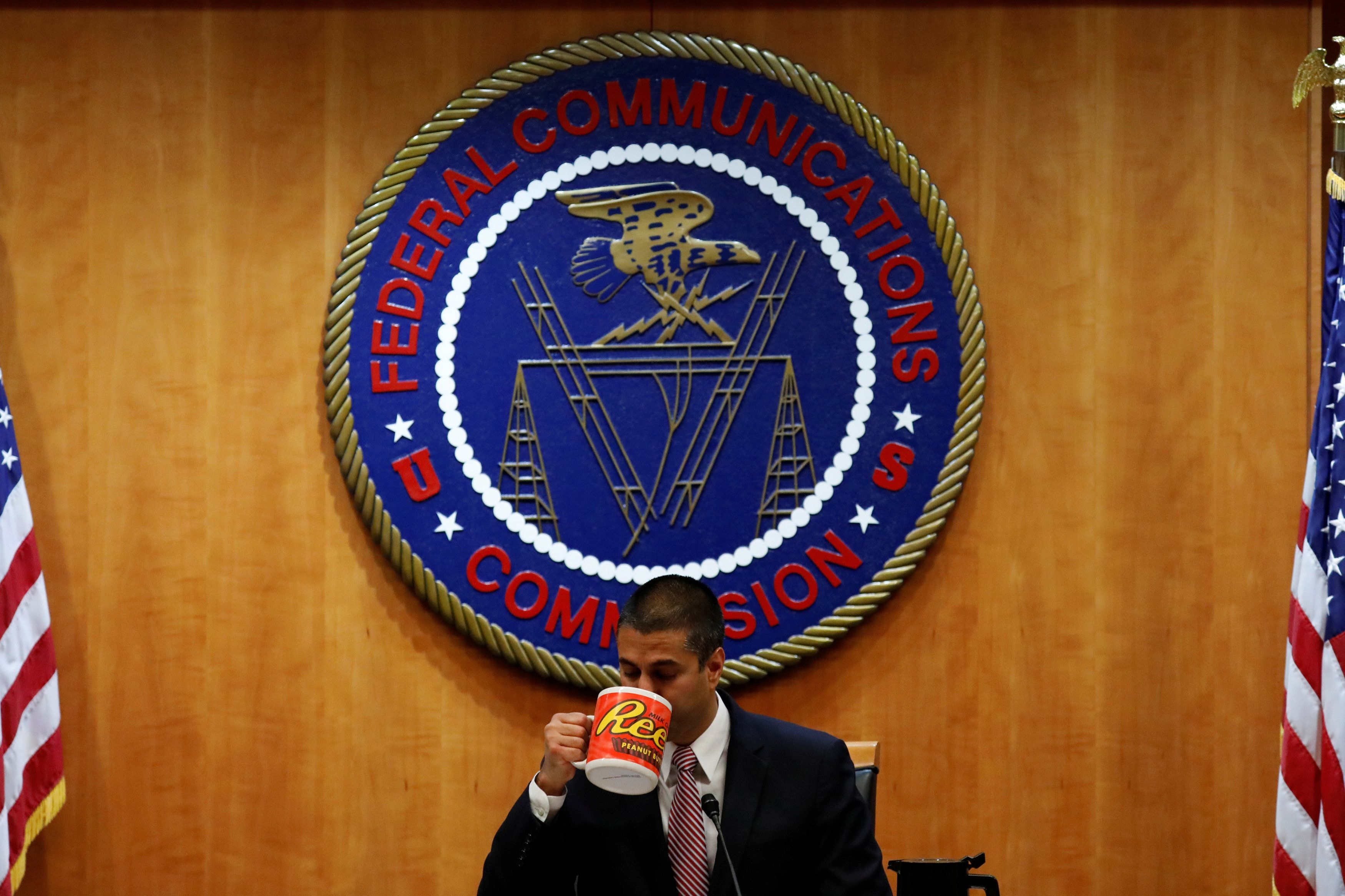 Chairman Ajit Paid drinks coffee ahead of the vote on the repeal of so called net neutrality rules at the Federal Communications Commission in Washington, U.S., December 14, 2017. REUTERS/Aaron P. Bernstein