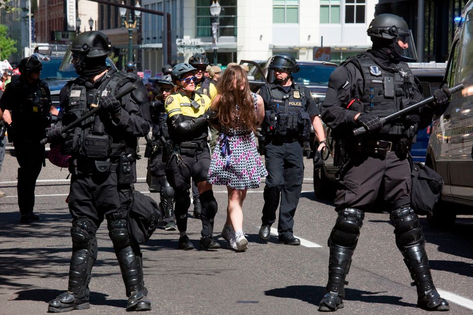 A woman is arrested after punching a member of Patriot Prayer during a rally in downtown Portland on Sept. 10, 2017.