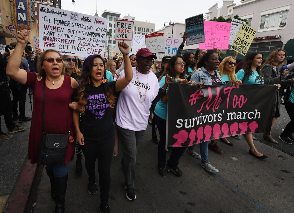 Victims of sexual harassment, sexual assault and sexual abuse and their supporters protest during a #MeToo march in Hollywood