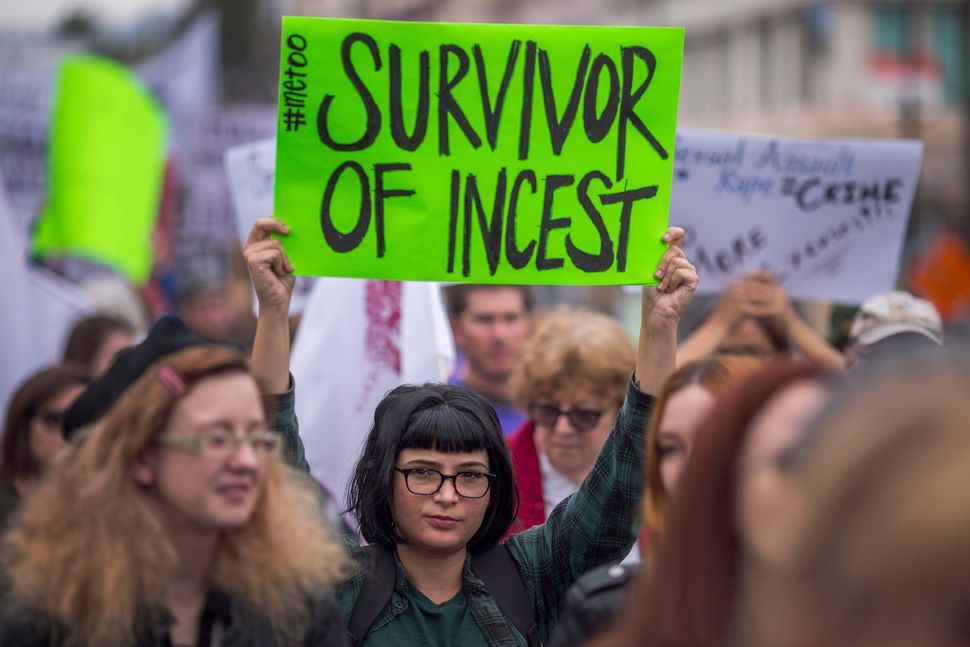 Demonstrators participate in the #MeToo Survivors' March outside the CNN building on Nov. 12, 2017, in Los Angeles.