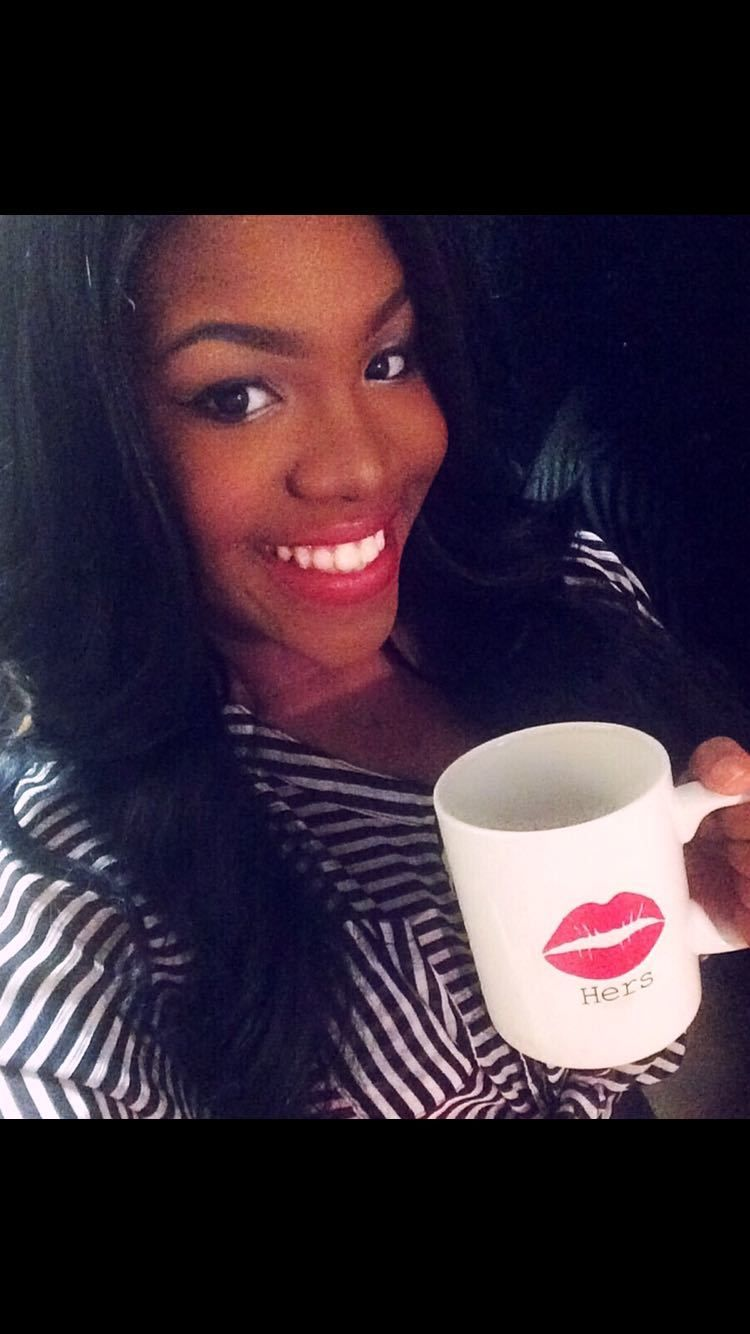 Narcisse James sipping on her favorite pastime, a cup of coffee!