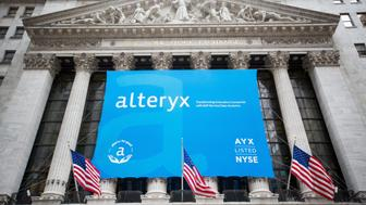 Alteryx Inc. signage is displayed in front of the New York Stock Exchange (NYSE) during the company's initial public offering (IPO) in New York, U.S., on Friday, March 24, 2017. U.S. stocks pared the worst weekly drop of the year, while Treasuries and the dollar continued to churn in a tight range as investors watched developments in Washington to gauge the prospects for the Trump administration's legislative agenda. Oil rose for the first time this week. Photographer: Michael Nagle/Bloomberg via Getty Images