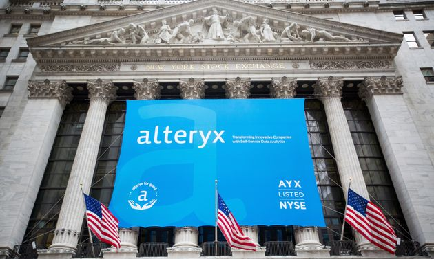 Alteryx signage is displayed in front of the New York Stock Exchange during the company's initial public...