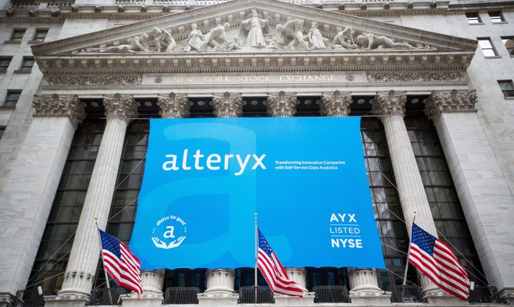 Alteryx signage is displayed in front of the New York Stock Exchange during the company's initial public offering, March 24,