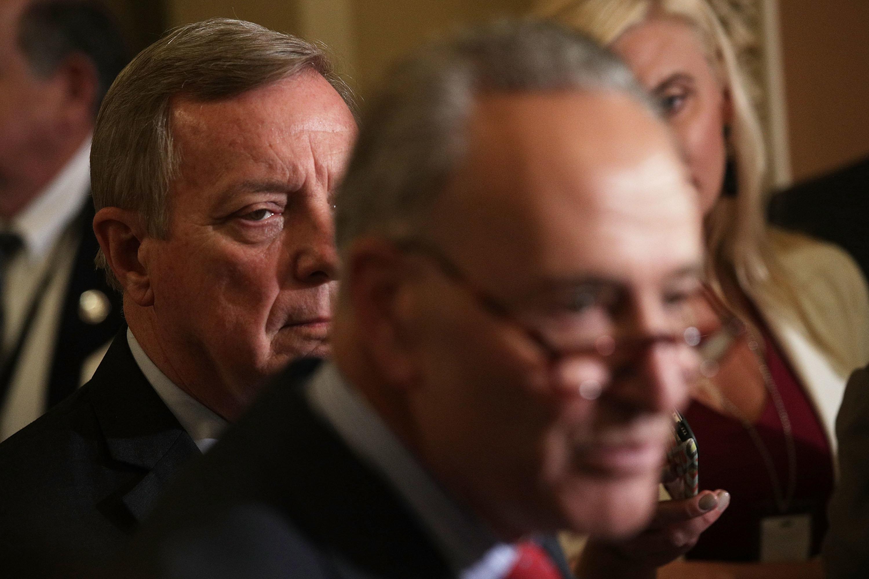 Senate Minority Leader Sen. Chuck Schumer (D-N.Y.) speaks as Senate Minority Whip Sen. Dick Durbin (D-Ill.) listens during a