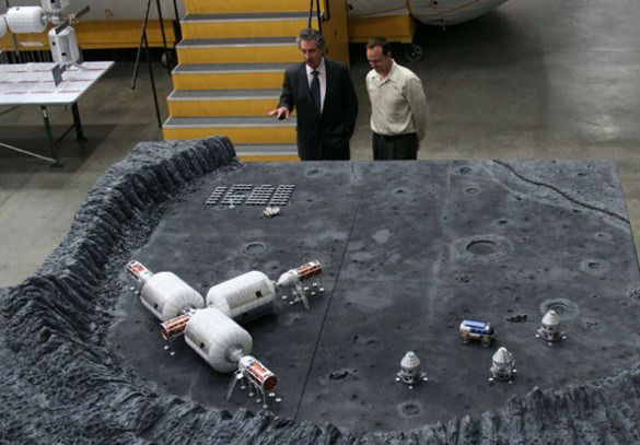 Robert Bigelow (left) and guest with a model of their plans for a lunar base.