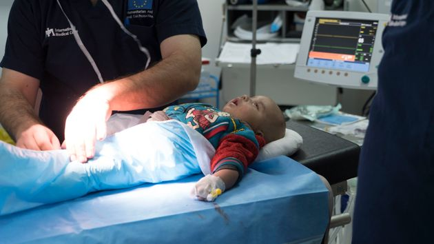 Separating babies from the mother, like this one in the Azraq camp, can disrupt bonding and