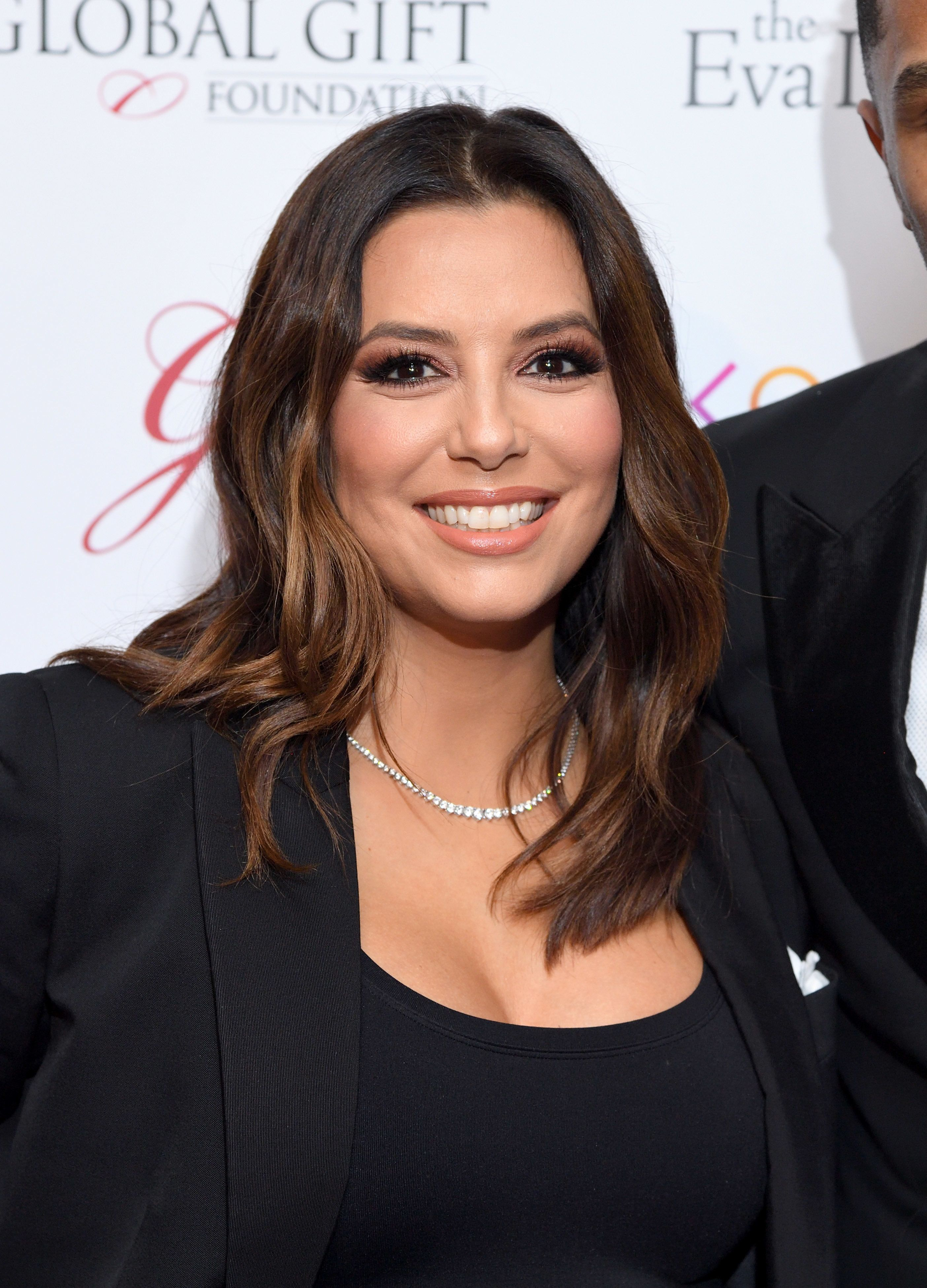 42-year-old Eva Longoria was wearing a sexy black suit for a photo shoot 02.08.2017 95