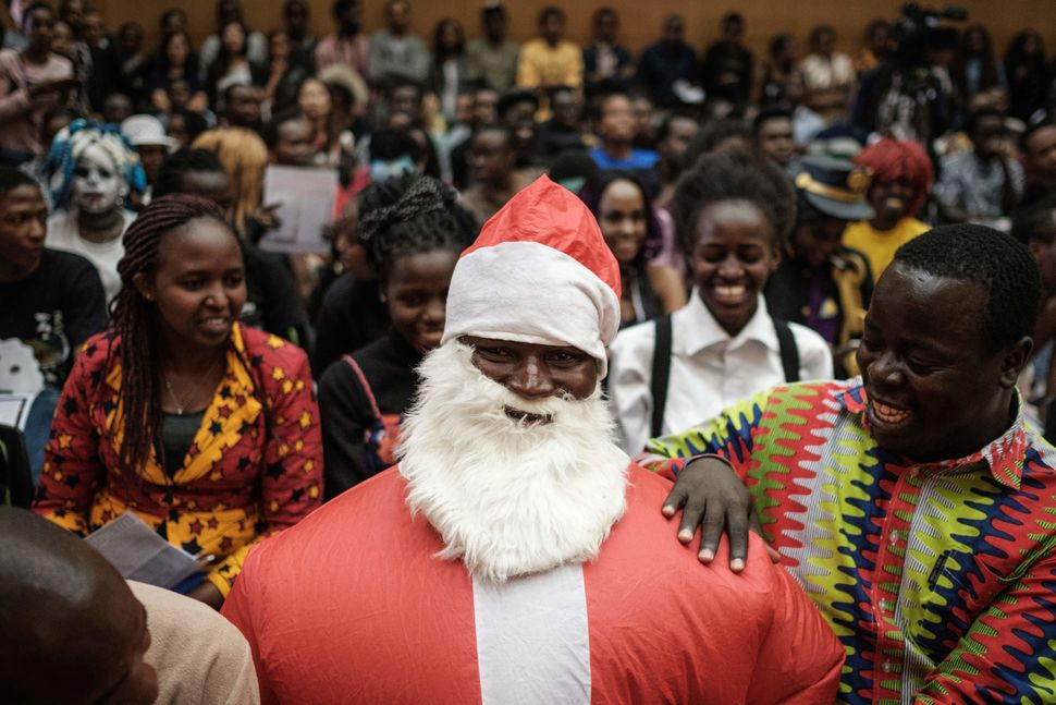 A participant in a Japanese singing contest wears an inflated costume of Santa Claus, on Dec. 9, 2017, at the Japan Info