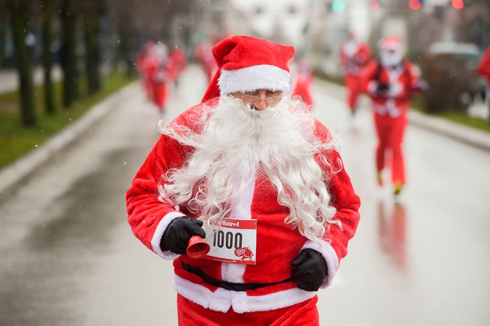 Runners dressed as Santa Claus take part in a charity race in Pristina, Kosovo, on Dec. 17, 2017, to raise funds for fam