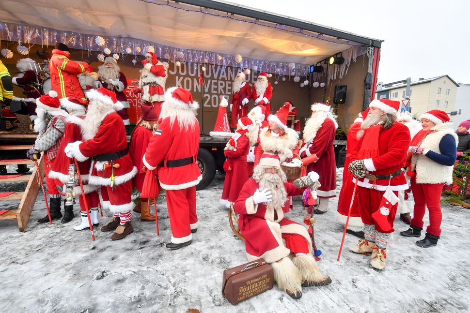 People dressed in Santa Claus costumes are seen during the 17th World Santa Clauses Summit parade held in Rakvere, Estonia, o