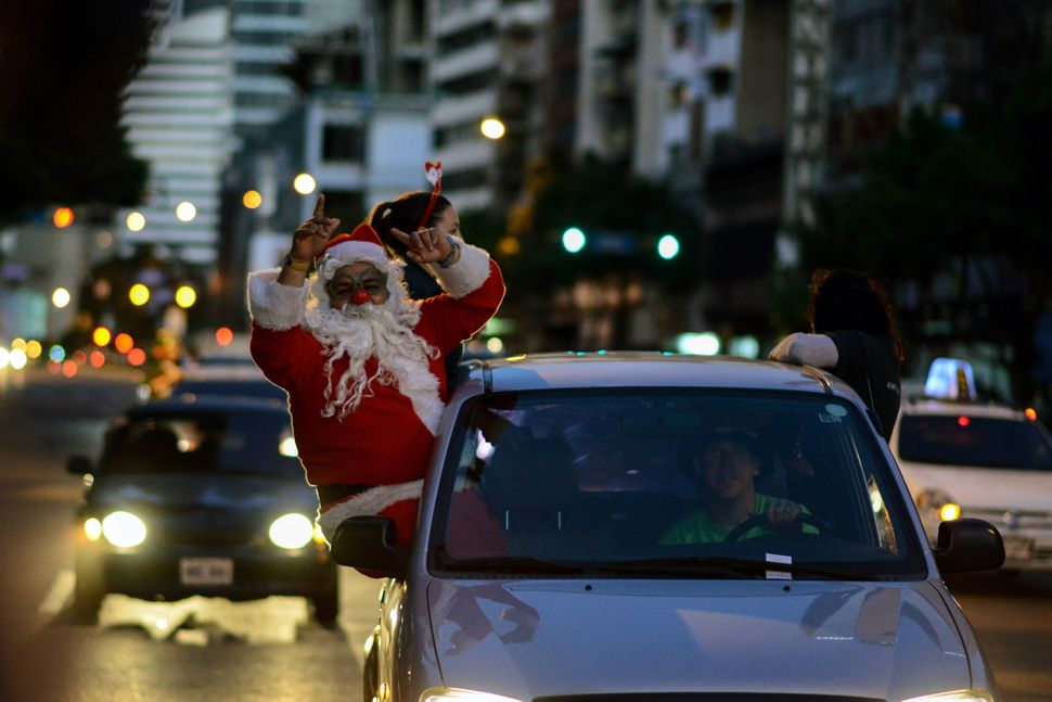 A man dressed as Santa Claus is seen during the event 'Santa en las calles' in the streets of Caracas, Venezuela, on Dec.&nbs