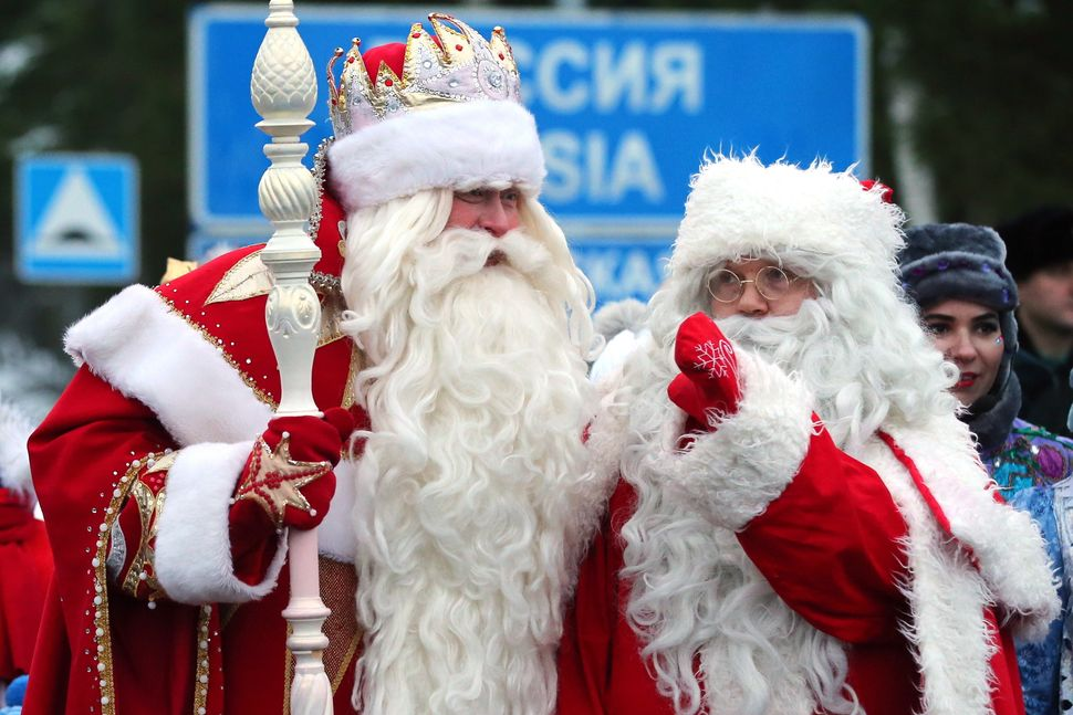 Russia's Father Frost, left, and Joulupukki (Finnish Santa Claus) meet at Brusnichnoye crossing on the Russian-Finnish border
