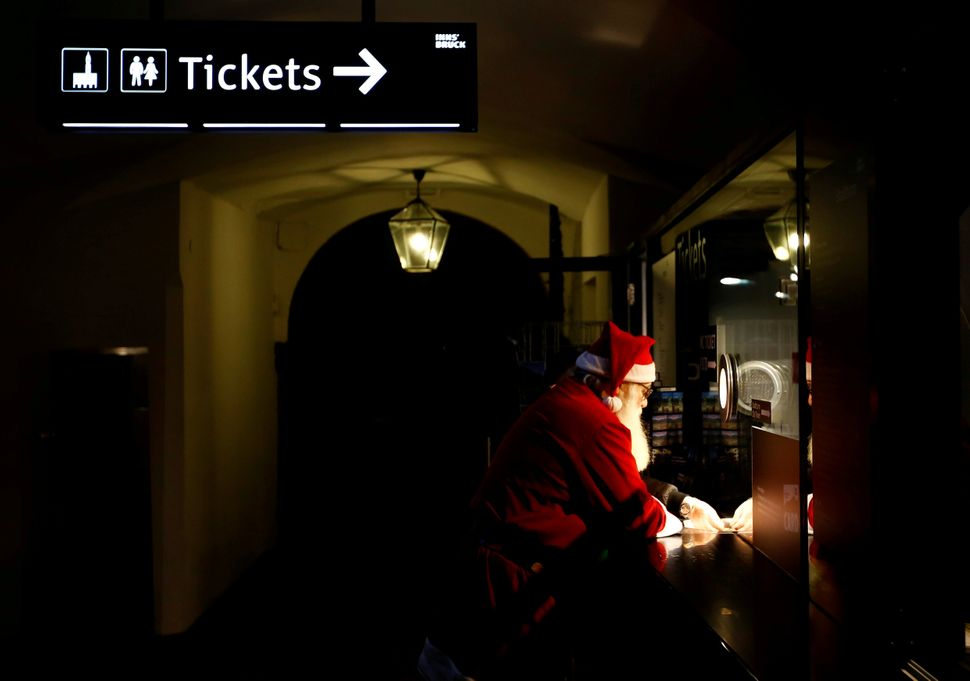 A man dressed as Santa Claus buys a ticket at the Christmas market in Innsbruck, Austria, on Nov. 29, 2017.