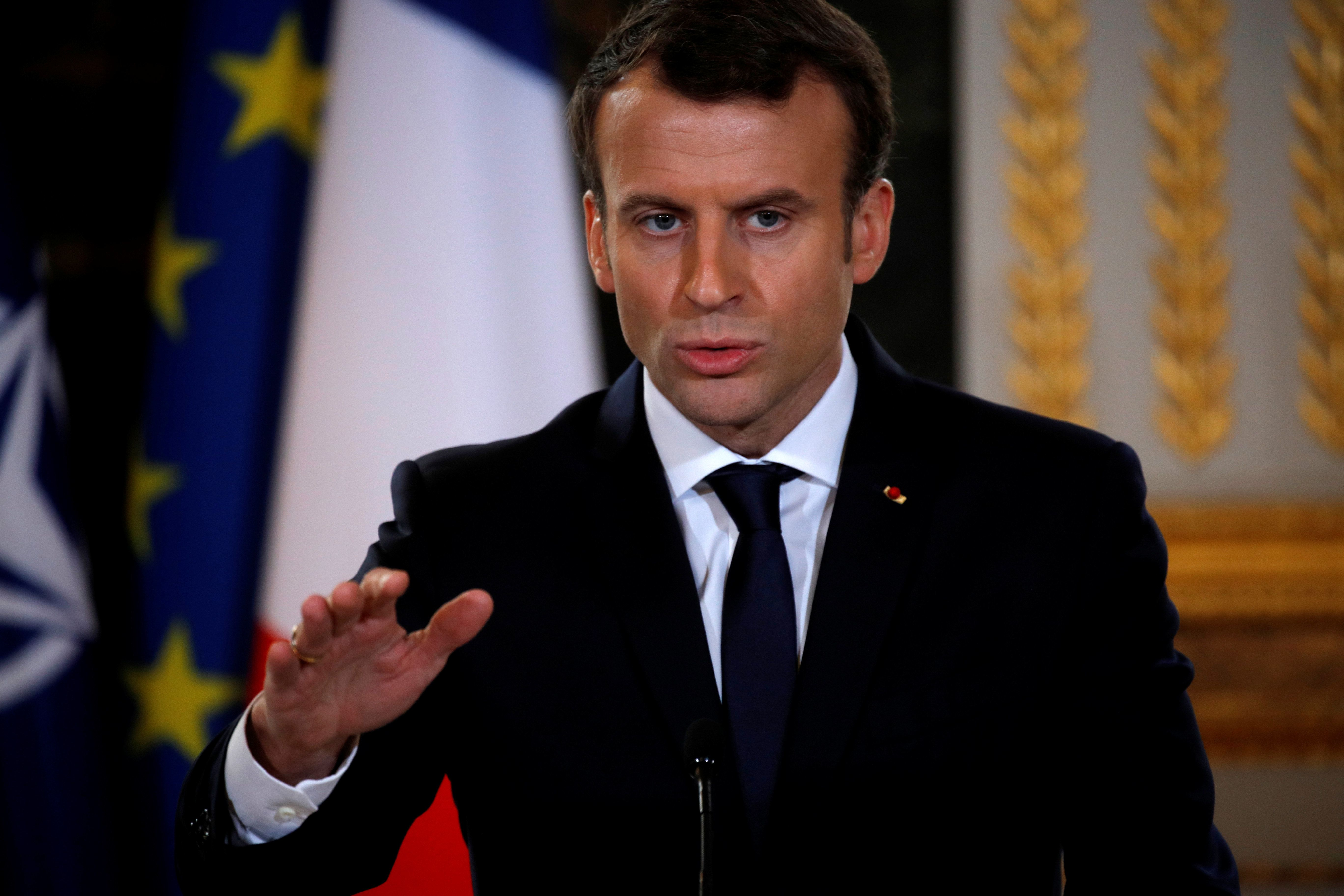 French President Emmanuel Macron attends a news conference with NATO Secretary-General Jens Stoltenberg (not seen) at the Ely