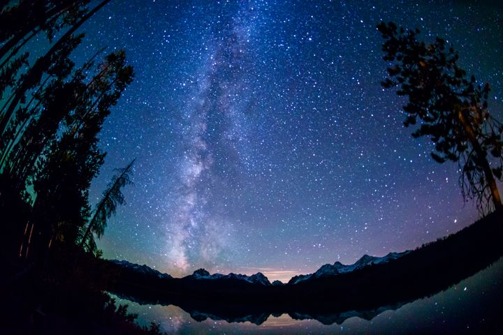 Little Redish Lake, nestled within the Sawtooth mountain range in central Idaho, boasts dazzling night sky views of the Milky