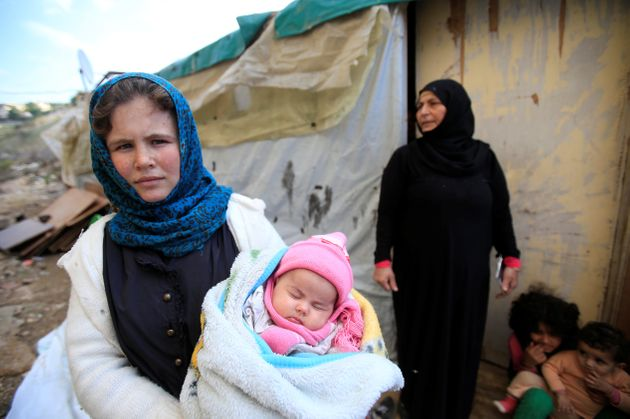 A Syrian refugee with her family in