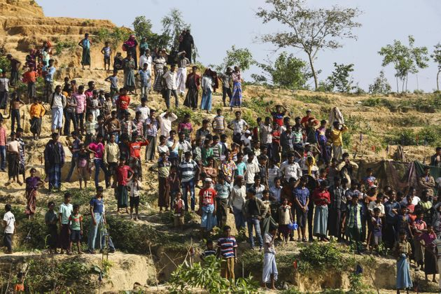 Displaced Rohingya Muslims at a refugee camp in