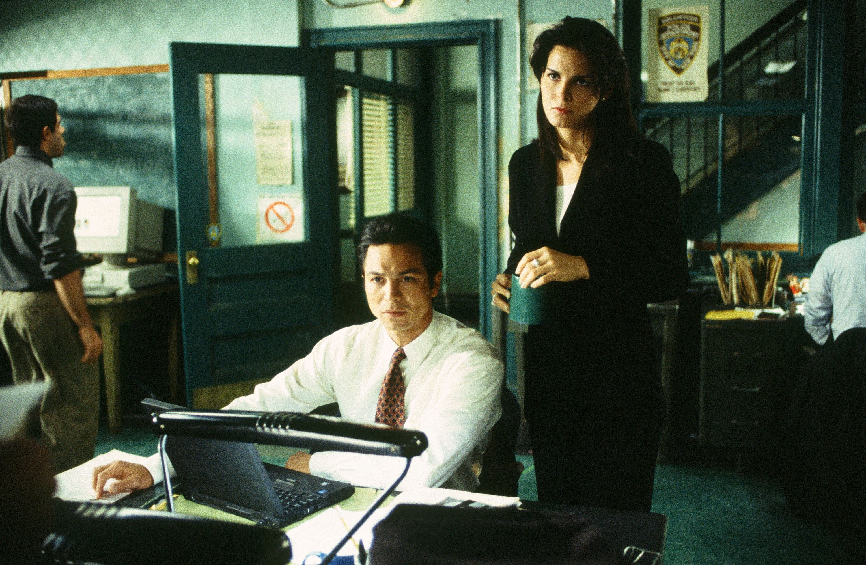 LAW & ORDER -- 'Refuge: Part 1&2' Episodes 23/24 -- Air Date 05/26/1999 -- Pictured: (l-r) Benjamin Bratt as Detective Rey Curtis, Angie Harmon as A.D.A. Abbie Carmichael  (Photo by Jessica Burstein/NBC/NBCU Photo Bank via Getty Images)