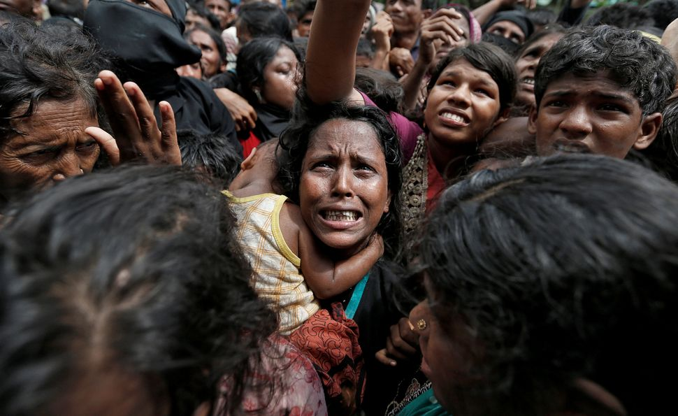 A woman cries out as Rohingya refugees wait to receive aid in Cox's Bazar, Bangladesh, on Sept. 21. Reuters photographer