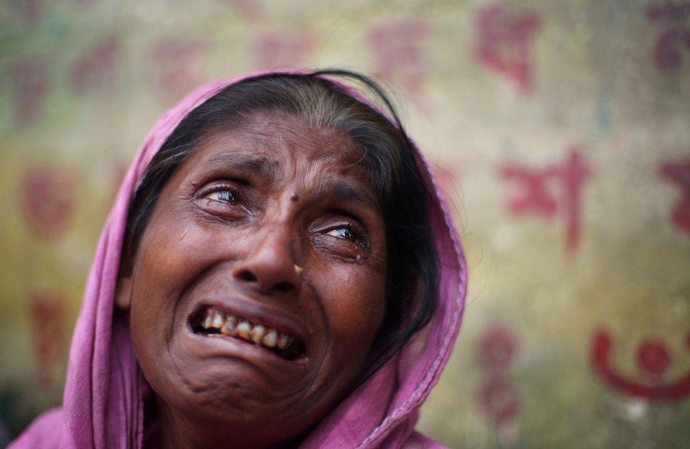 Kulsuma Begum, a 40-year-old Rohingya refugee, cries in Cox's Bazar, Bangladesh, on Oct. 27. Reuters photographer Hannah McKa