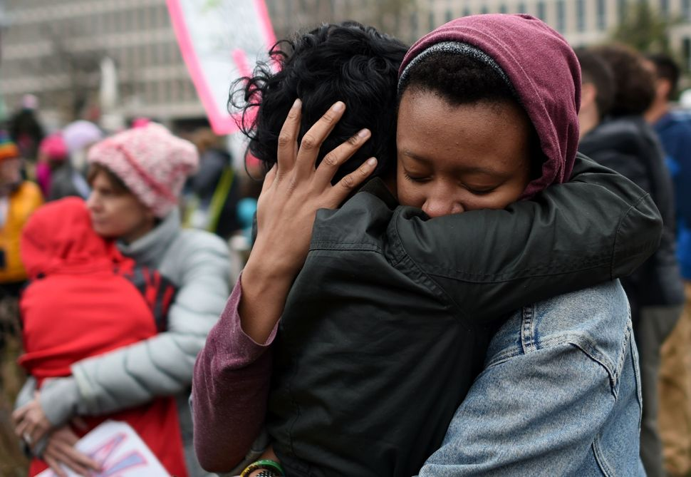 Demonstrators hug during protests on the National Mall in Washington, D.C., on Jan. 21, 2017.