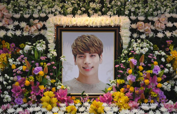 The portrait of Kim Jong-Hyun, a 27-year-old lead singer of the massively popular K-pop boyband SHINee, is seen on a mourning