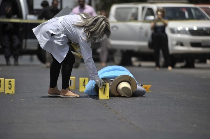 The body of Mexican journalist Javier Valdez lies on the street after he was shot dead in May.