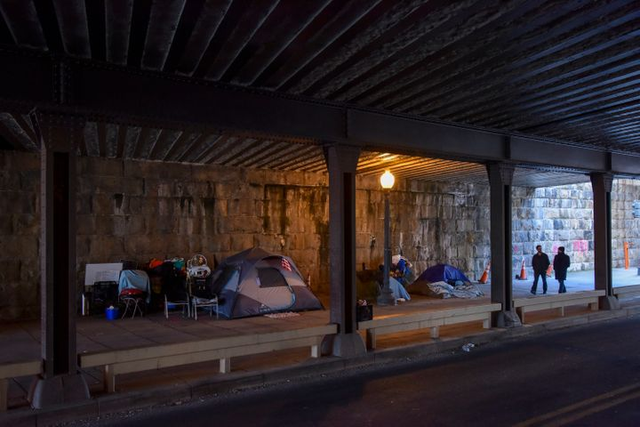 Pedestrians pass an expanding tent city under an overpass in Washington, D.C., last week.