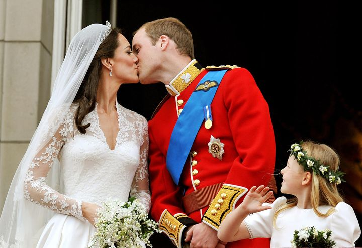 Prince William kisses his bride on the balcony of Buckingham Palace.