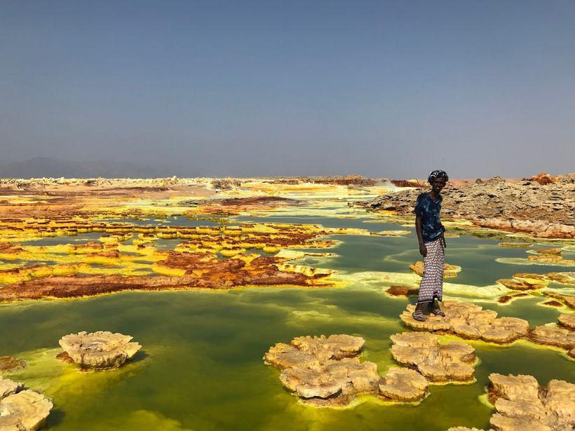 Arata, our Afar guide, leading us across the Dallol pools